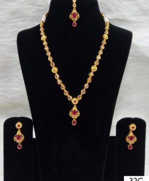 Golden and Red Diamond Work Necklace Set with Maang Tika